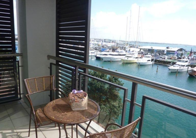 Sunny balcony off the lounge area. - Waterfront Two Bedroom Serviced Apartment in the Heart of the Viaduct Area, Auckland, NZ - Auckland - rentals
