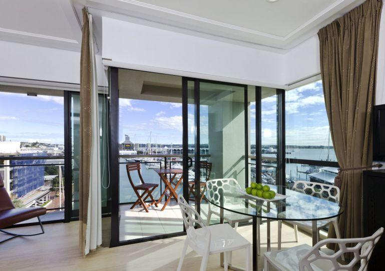 Sunny living area opens onto the deck. - 2 Bedroom Serviced Apartment in The Sebel Suites Hotel, Auckland Viaduct Area - Auckland - rentals