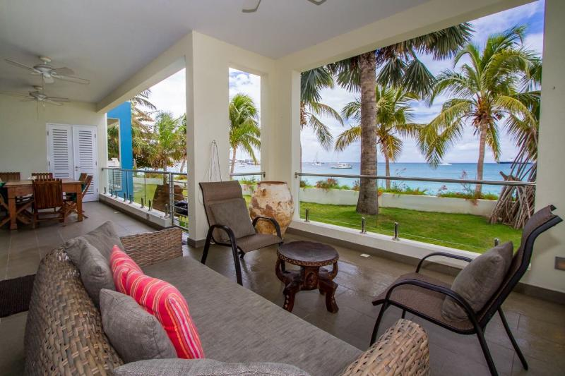 Very spacious terrace with comfortable sitting, dinning area and an amazing view - Le Papillon - Luxury on the Beach / no car needed - Simpson Bay - rentals