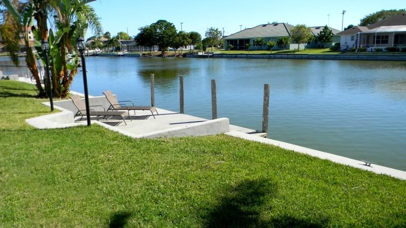 Dock by the water - House on a canal in established neighborhood - Cape Coral - rentals