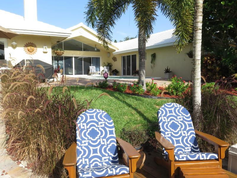 Tropical backyard with private pool, large patio, dock, and deck on the water. - Luxury Waterfront Home, pool & 1 mile to beach - Deerfield Beach - rentals