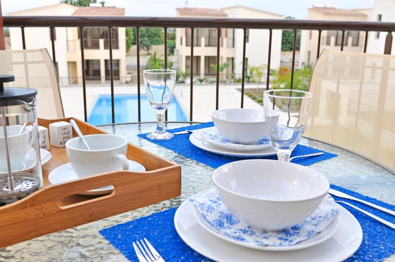 Enjoy your meals al fresco on the balcony - Brand new apartment with pool view - Zyyi - rentals