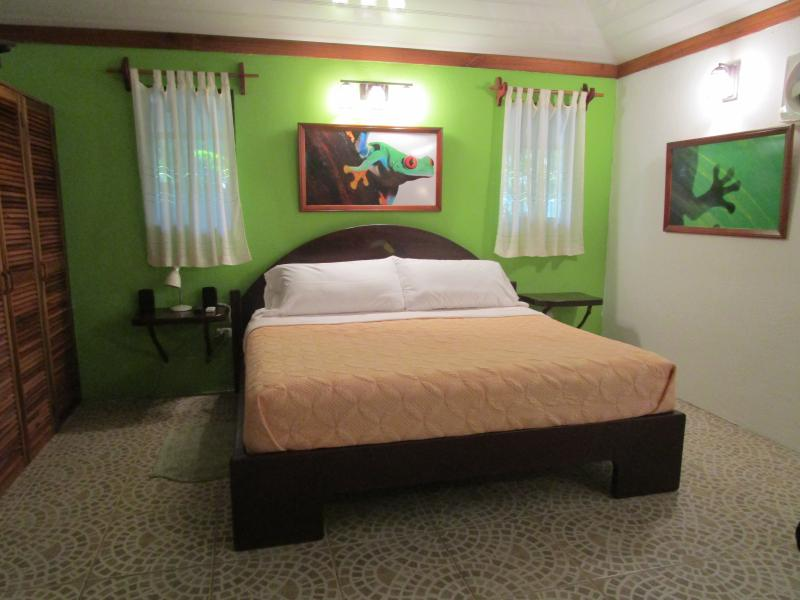 "California King sized bed w/ quality mattress and linens. A/C, Wifi, Satellite TV, Screened Patio - ""OWNER'S CABIN at the Toucan Stay Inn A/C, WiFi, KING BED - Punta Uva - rentals"