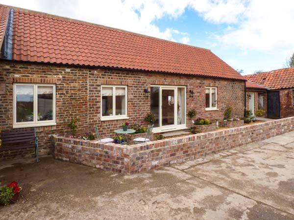 THE BYRE, red brick barn conversion, all ground floor, en-suite, parking, patio, in Northallerton, Ref 924364 - Image 1 - Northallerton - rentals