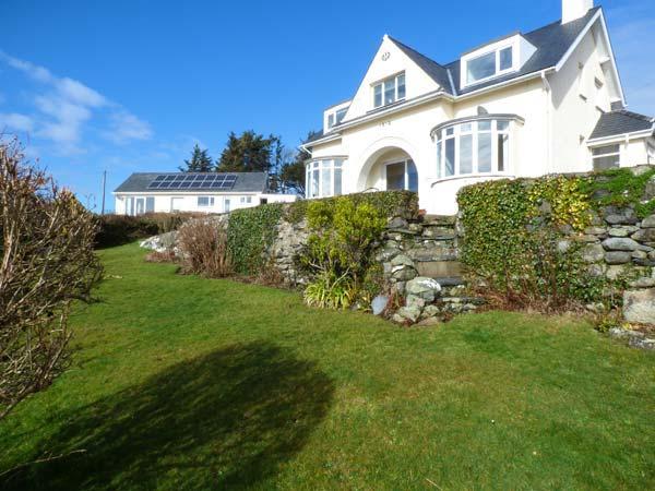 BRYN HOEL, detached, double bay fronted cottage, sea views, roll-top bath, off road parking, in Llanfair, Ref 905040 - Image 1 - Llanfair - rentals