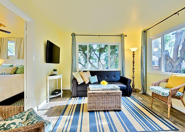 The sun filled living room - Newly remodeled cottage just steps to beach with private deck and shared spa! - La Jolla - rentals