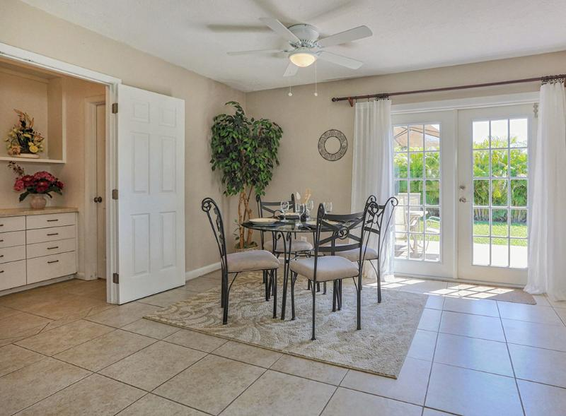 Double French doors let lots of that Florida sunshine in! - Breezy Villa Tropical Retreat w Private Beach/WiFi - Venice - rentals
