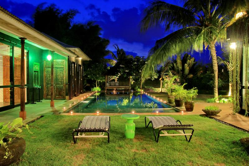 Nights view of swimming pool overlooking at tropical garden and paddy field - Spacious, High Standing Villa with rice field view - Canggu - rentals