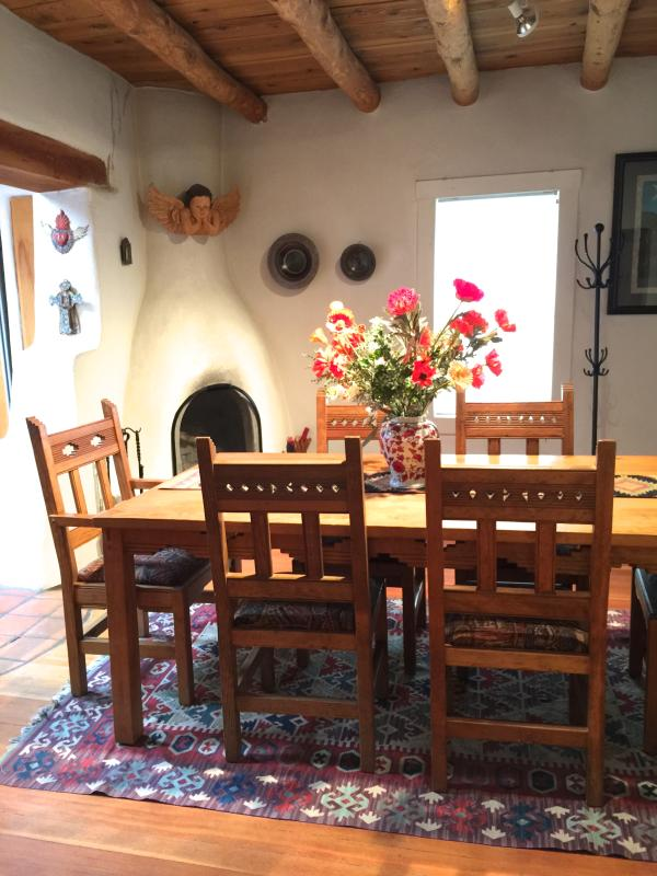 Dining easily seats six - Kiva fireplace - Classic Adobe East Side near Canyon Road - Santa Fe - rentals