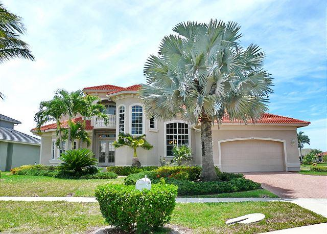 Spacious waterfront house w/ heated pool & upstairs balcony with water view - Image 1 - Marco Island - rentals