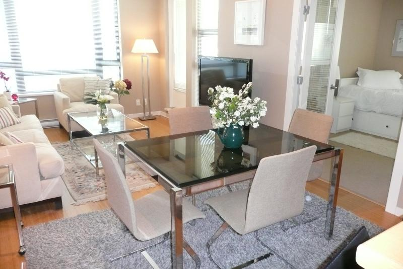 "The open plan living/dining room has a 46"" TV, DVD player, Bose stereo radio with CD player and WiFi - Perfect Downtown  Vacation Apartment - Victoria - rentals"