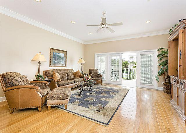 Gleaming hardwoods and comfy furnishings in the living room - Villas Ocean Gate 429 - Montega Bay Unit, Pool - Saint Augustine - rentals