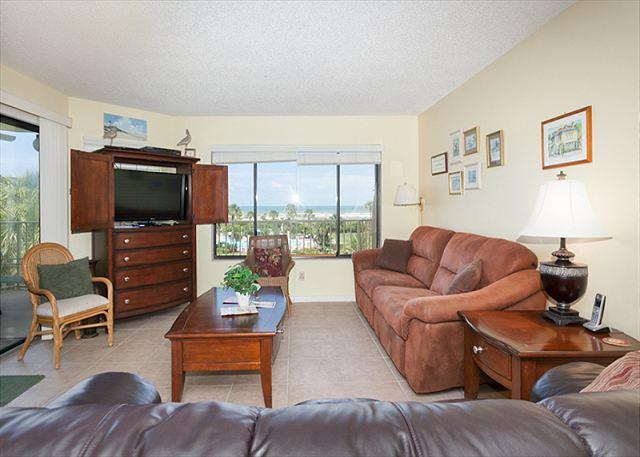 You'll love this airy, well-appointed living area with big TV! - Colony Reef 3302, 3rd floor, 3 Bedrooms, Heated Pool, St Augustine - Saint Augustine - rentals