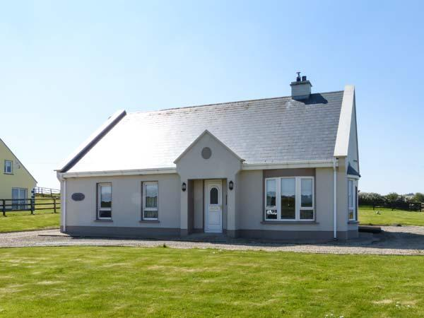 SEASCAPE COTTAGE, sea views, Sky TV, solid fuel stove, en-suite, large gardens, near Lahinch, Ref. 921913 - Image 1 - Lahinch - rentals