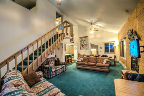 Spacious Living Area with Vaulted Ceilings, Gas Fireplace, and Deck Access - Buntrock Chalet - Steamboat Springs - rentals