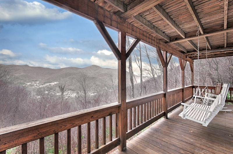Incredible views from the lower deck. Swing on the swing or rock in the rockers. - Falcon Ridge - Mountain Views, Hot Tub, Fire Place - Maggie Valley - rentals