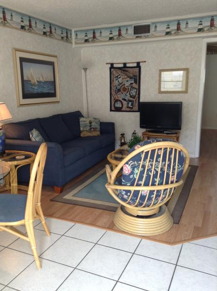 Beautiful living room with new flooring and flat screen TV and sleeper sofa - Just beaching ! Sea & Sun. Condo   Sleeps 4 - Gulf Shores - rentals