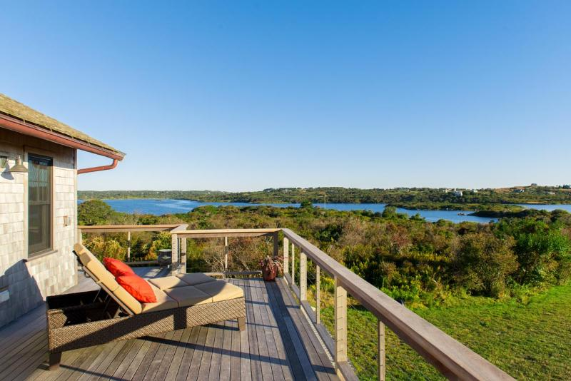 One of many pond and ocean vistas from the wraparound deck.  This view is of Squibnocket Pond. - SAWYW - Squibnocket Farm Oceanviews,  Private Beaches, Designer Luxury throughout, Private  Gated Community - Chilmark - rentals