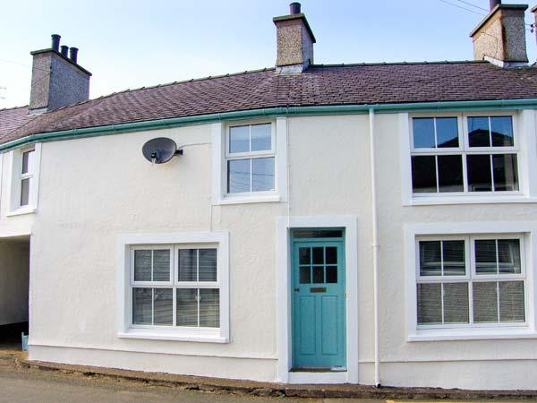 ANWYLFA, adaptable sleeping, enclosed garden, opposite pub, character cottage - Image 1 - Llanfechell - rentals