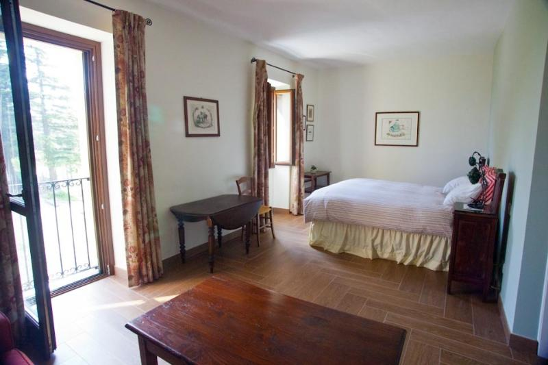 Our spacious guest bedroom is comfortably furnished. - Piedmont Farmhouse B&B, Italy - Calamandrana - rentals