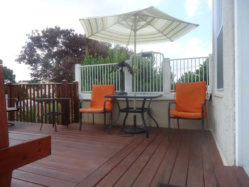 Deck by private entrance to 2nd floor, tables, built-in bench, etc. - Beautiful Home--Walk to Beach, Restaurants, Shopping & Entertainment District! - Daytona Beach - rentals