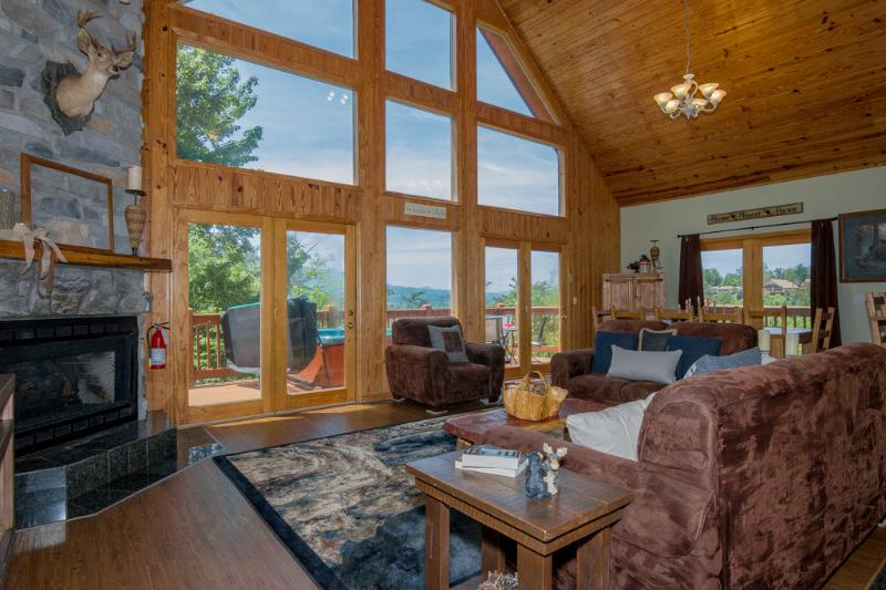 Wall of windows lets you enjoy the terrific mtn view from inside the cabin too! Fireplace to left. - Spring from $199/nt~Window to Paradise~3 KG Masters, Mtn View, Fab Gm Rm, Pools - Gatlinburg - rentals