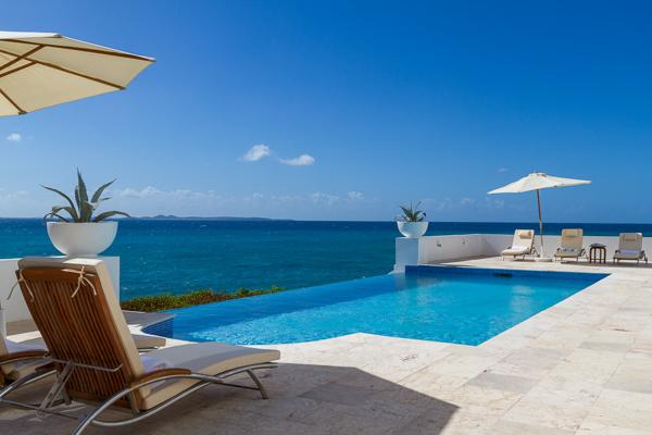 With an infinity pool overlooking the sea and St. Martin, this villa, on a private small beach, also has great snorkeling. IDP VIS - Image 1 - Little Dix - rentals