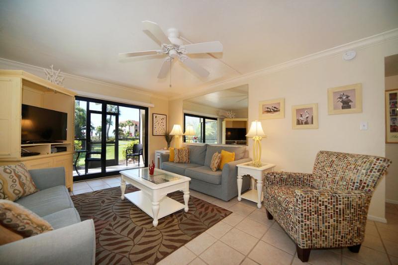 Living Room looking towards lanai 3D1 - SANDALFOOT 3D1--2 BR MAGICAL RETREAT (1st floor) - Sanibel Island - rentals