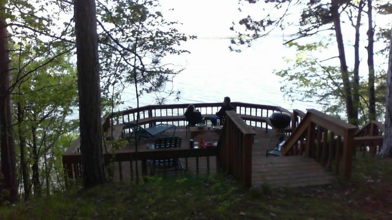 The view from our [your] private deck, overlooking the lake. - Higgins Lakefront Cottage & dock, in Deep Woods - Higgins Lake - rentals