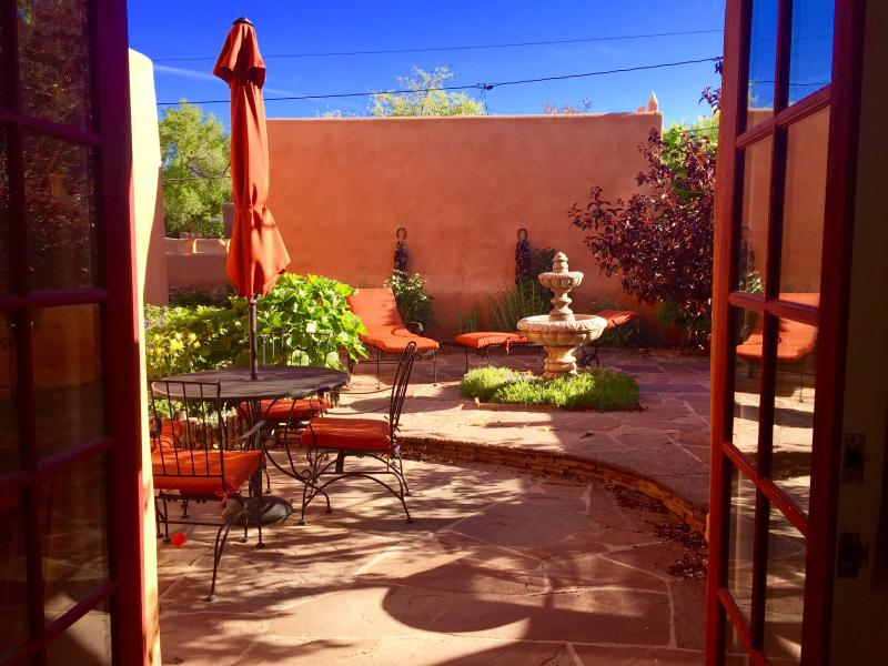 Kitchen open to Beautiful Courtyard: Outdoor Dining, Chaises, Infrared BBQ, Fountain - Luxury Adobe, Walk Everywhere, Oct.18-28 only $395 - Santa Fe - rentals