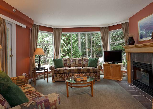 Cozy Living Area with Gas Fireplace - Woodrun Lodge #416 | 1 Bedroom + Den Ski-In/Ski-Out Condo, Shared Hot Tub - Whistler - rentals