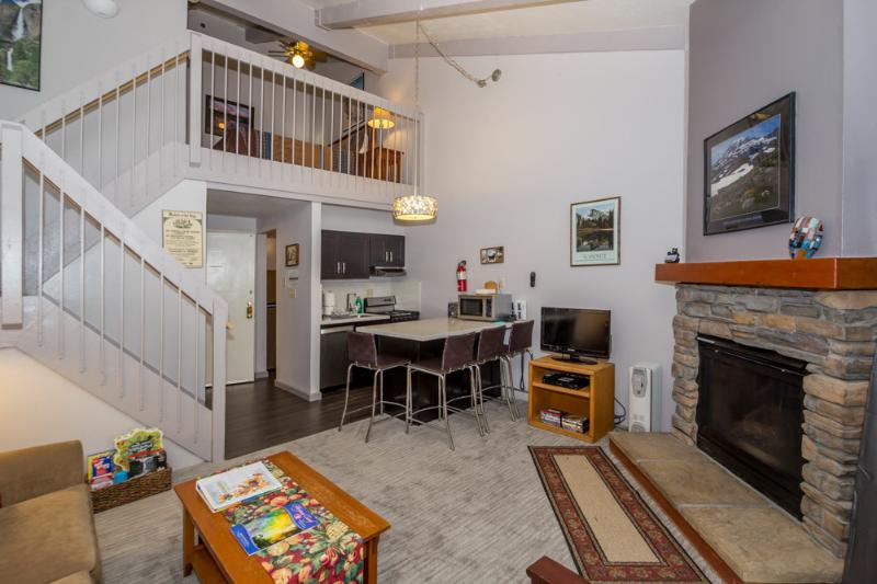 View of your living area, kitchen, gas fireplace and loft. - Charming Studio Loft Condo Inside the Park! - Yosemite National Park - rentals