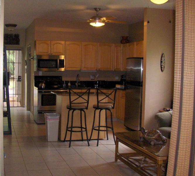 Kitchen and part of living area, view from the Lanai - Let This Gorgeous Condo Dazzle You.... - Lahaina - rentals
