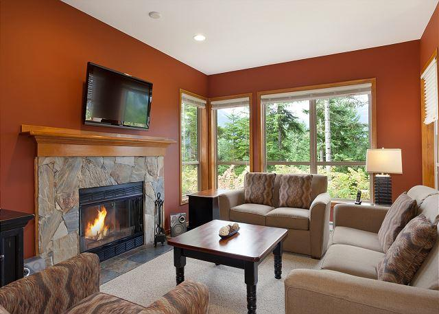 Living Room with Fireplace, Flat Screen TV and Forested Views - Painted Cliff 20 | Comfortable 2 Bedroom Ski In/Ski Out Townhome with Parking - Whistler - rentals