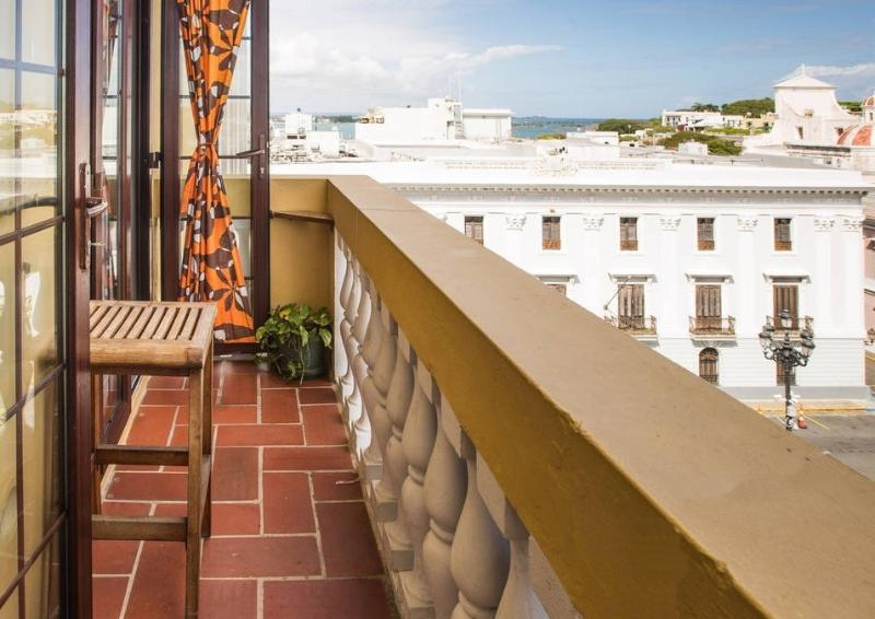 Full-size balcony with partial view of the San Juan Bay. See the cruise ships pass by. - Old San Juan Vintage Apt. on Main Plaza: 4-NT MIN - San Juan - rentals