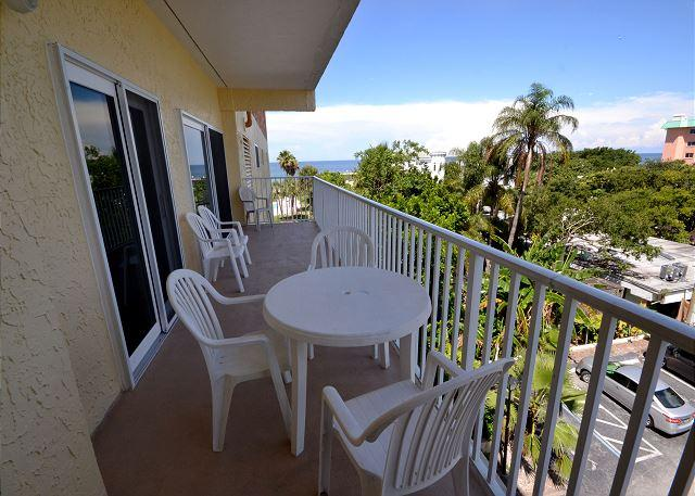 Large Balcony with Seating and View of the Gulf - San Remo 303 - Spacious 2 Bedroom with Gulf View Balcony & Gulf Front Pool - Redington Shores - rentals
