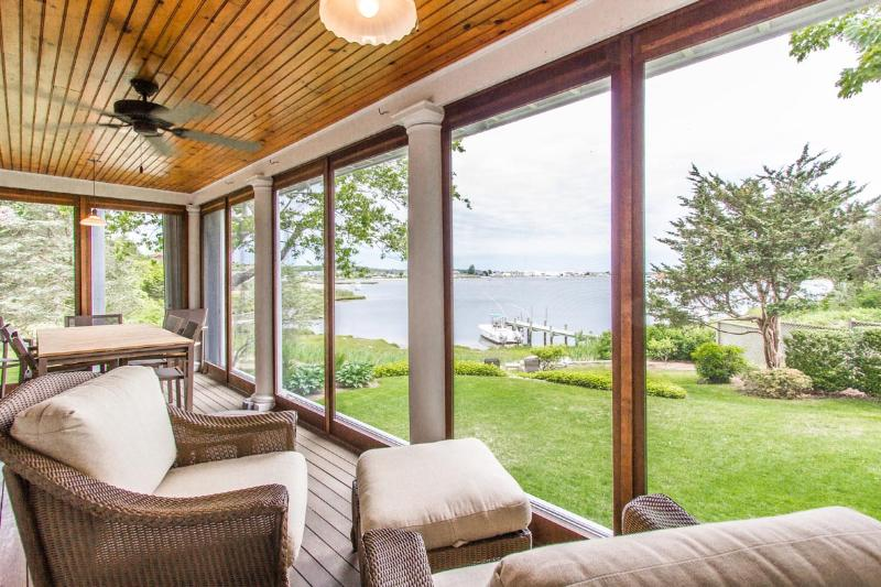 Screened Porch and Views Across Lawn to Lagoon - MILLH - Impeccable Lagoon Waterfront Cottage, Designer Details, Gorgeous Views and Lanscaping, 2nd Level Deck, Screened Porch - Vineyard Haven - rentals