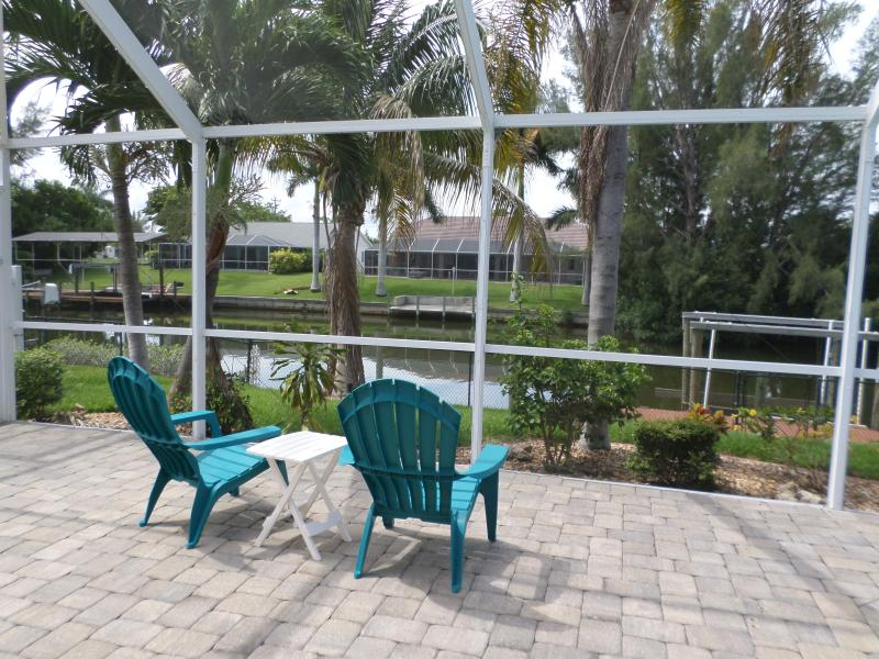 Get a beverage and a tan, watching the protected Herons that live across the canal - Villa Savannah Dawn w/ Heated Pool/Canal/Boat Lift - Cape Coral - rentals