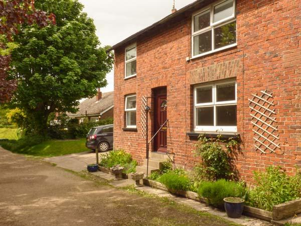 THE OLD MILL COTTAGE, end-terrace, woodburner, pet-friendly, enclosed garden, near Filey, Ref 919215 - Image 1 - Filey - rentals