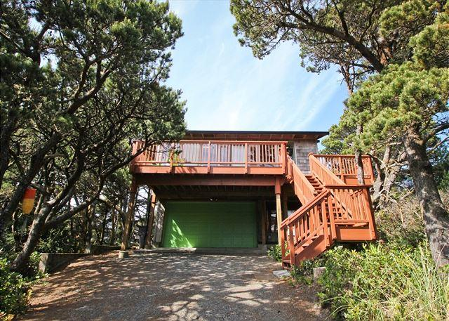 Front view of Spindrift House from the road-15 stairs to entry door. - SPINDRIFT~Nestled in the tree's only a block to the beach!! - Manzanita - rentals