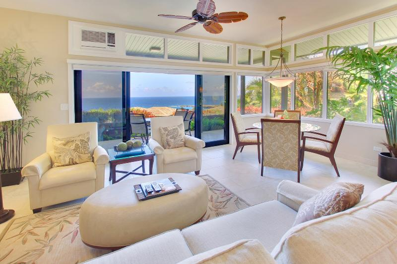Elegantly appointed living room opens up to spacious ocean view lanai with private dining table - Luxurious Platinum Ocean View Ridge/Discount Golf - Kapalua - rentals
