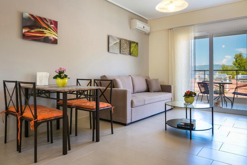Tangerine Living Area - Eucalyptus Apartments - Tangerine - Sami - rentals