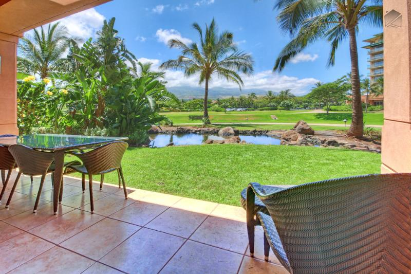 Enjoy some outdoor time on your ground floor lanai looking out at the pond. - Ground Level, Just a Few Steps to the Pool and BBQ - Mua Laina at 110 Konea - Lahaina - rentals