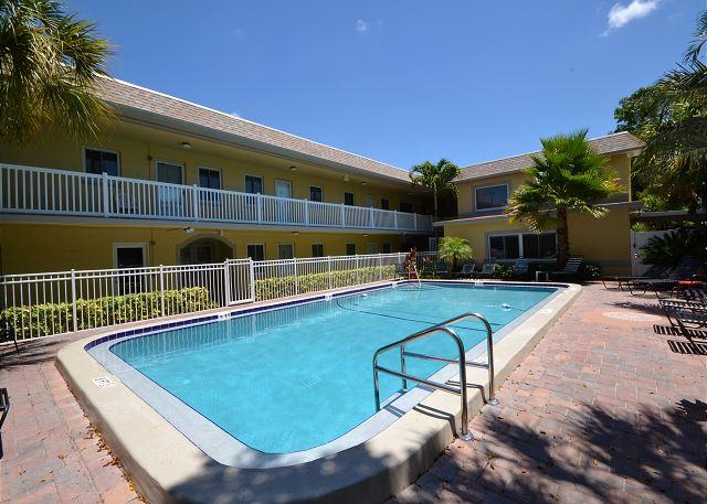 Waves 16 - 2nd Floor Condo overlooking Courtyard/Pool!  BBQ, Free Wifi w W/D! - Image 1 - Saint Pete Beach - rentals