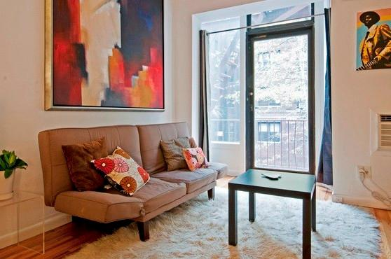 The living area has a small balcony overlooking a tree lined street - Charming loft studio near UN-sleeps 4 - New York City - rentals