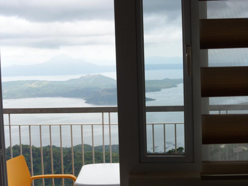 Day time view from apartment balcony - Blowing in the Wind - Taal Lake views - Tagaytay - rentals