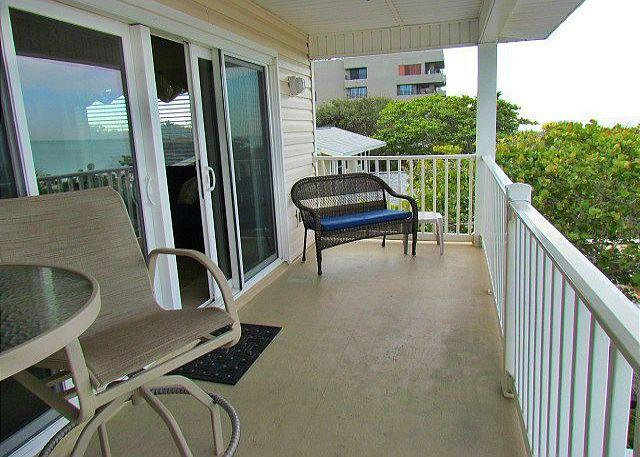 Balcony - Beachfront Paradise at Island Sands 204 Awaits you in November and December! - Indian Rocks Beach - rentals