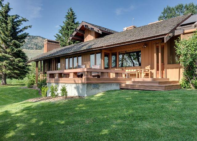 From the kitchen is a modest deck overlooking the pond - Green Mountain Ranch - Bozeman - rentals