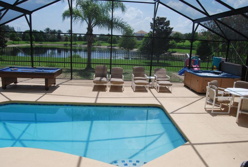Wonderful hige pool area overlooks lake with fountain that lights up at night - Close To Disney, Gameroom, Private Pond Backyard - Kissimmee - rentals