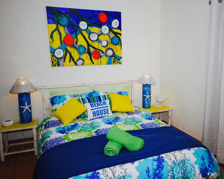Bright and beachy- the queen sized bed downstairs. - Lime Cottage at Burnett Heads - Burnett Heads - rentals